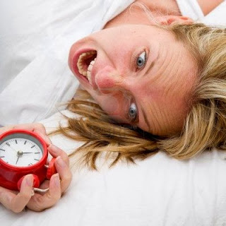5463364-woman-with-red-alarm-clock-representing-lateness-or-a-deadline